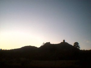 da' shadowed side of chimney rock at sunset