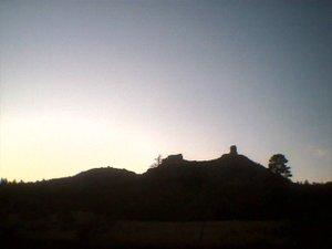 da' shadowed side of chimney rock at sunset
